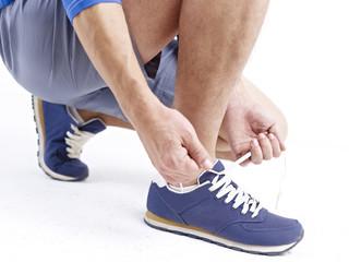 tying up shoelace
