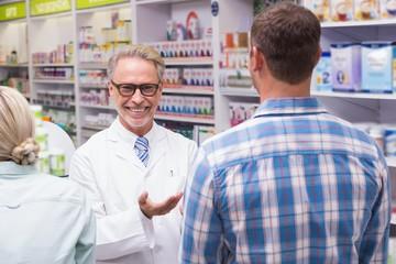 Smiling pharmacist looking at camera
