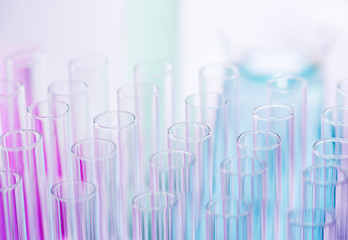 Blue and pink liquid in test tubes in a rack