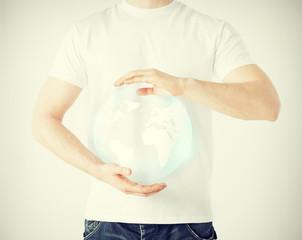 man hands holding sphere globe
