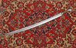 Leinwanddruck Bild - Circassian cavalry sword  in a sheath on the carpet