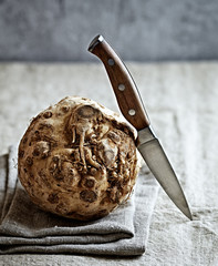 Rustic celery root and a kitchen knife
