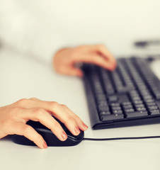 woman hands with keyboard and mouse