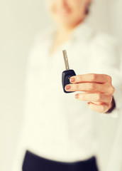 woman hand holding car key