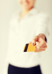 woman showing gold credit card