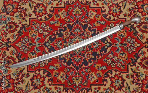Leinwanddruck Bild Circassian cavalry sword  in a sheath on the carpet