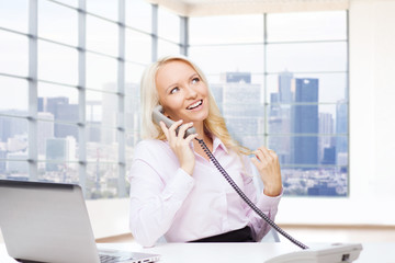 smiling businesswoman calling on telephone