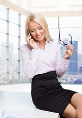 smiling businesswoman or secretary with smartphone