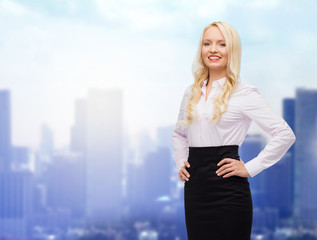 smiling businesswoman or secretary over city