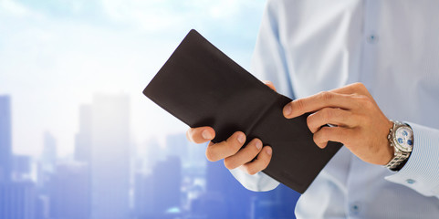close up of businessman hands holding open wallet
