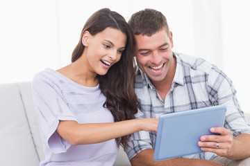 Couple using tablet PC together
