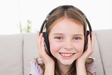 Happy girl listening music through headphones