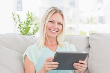 Happy woman using digital tablet