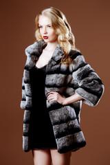posing in fur coat