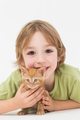 Cute boy with kitten over white background