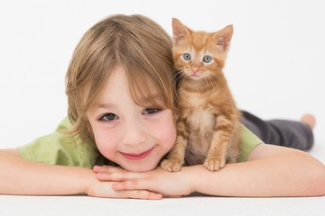 Boy with kitten over white background