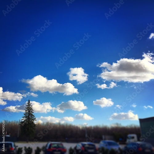 canvas print picture Sunny Sky over Parking place