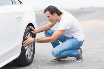 Man checking the wheels