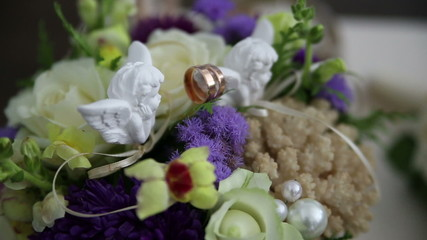 wedding rings and floral decorations