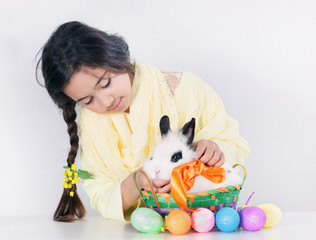 Little girl and soft white bunny