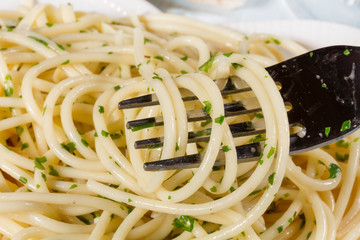 Spaghetti with cheese and fresh parsley closeup