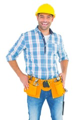 Confident handyman standing with hands on hips