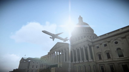 Airplane flying over The United States Capitol in Washington, DC