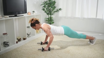 Beautiful woman doing push-ups