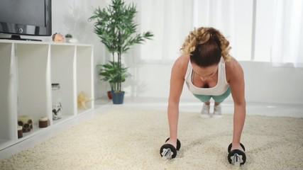 Beautiful woman doing push-ups