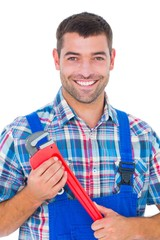 Confident male repairman holding monkey wrench
