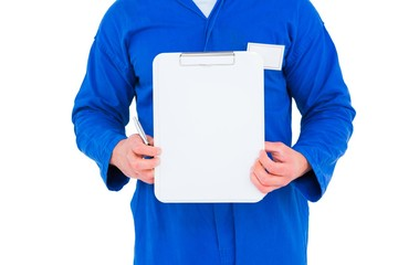 Male mechanic holding clipboard