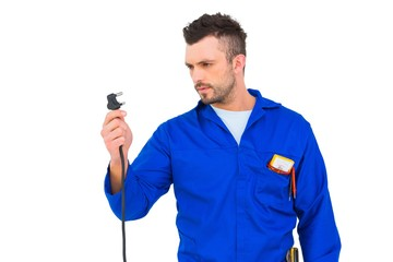 Electrician looking at plug