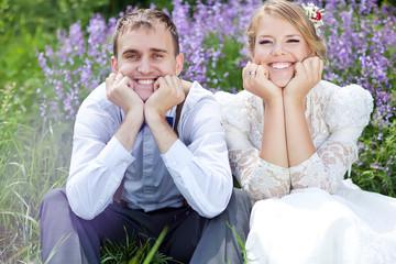 bride and groom in flower garden