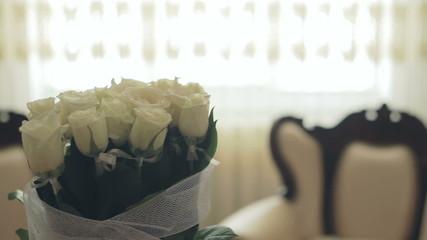 White room interior, window, white roses, pillows