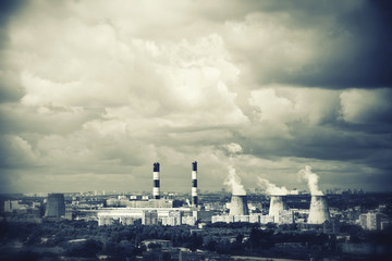 Industrial plants with smoking chimneys in the city