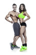 beautiful young sporty couple with a measuring tape