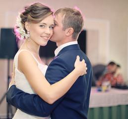 wedding photo, bride and groom embracing at wedding