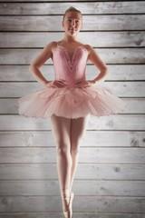 Composite image of pretty ballerina in pink standing en pointe