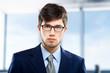 Handsome businessman against blurry background