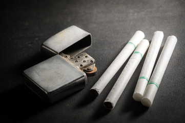 Cigarettes with old metal lighter.