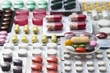 background of tablets, capsules and vitamins in blisters