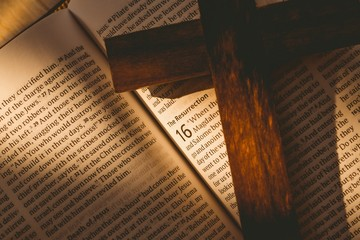 Open bible and wooden cross