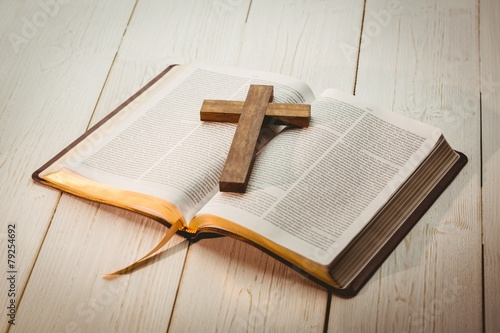 Open bible and wooden cross - 79254692