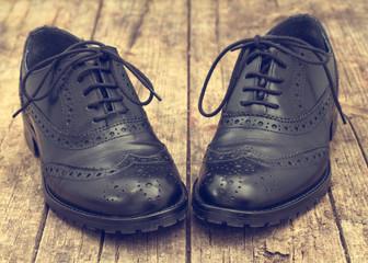 Stylish black brogue shoe. Vintage effects