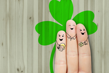 Conceptual St. Patricks finger art. Friends are drinking beer.
