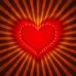 red heart with rays on a grunge  background