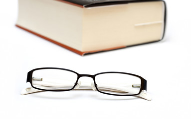 Thick book and glasses