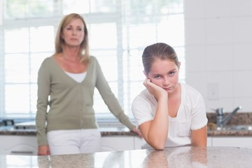 Little girl sulking after am argument with her mother
