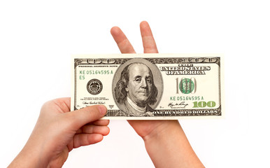 Children Hand holding 100 dollars (one hundred dollars banknote)