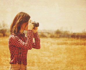 Woman photographer with old photo camera, vintage image